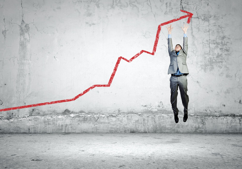a man climbing on a stock market arrow